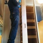 Ken Longo of Ken Longo Design working at the shop on the pantry