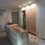 Island and pantry with lights in place